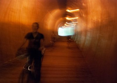 While cycling through the tunnel, we listen to the sounds of our echoing voices.